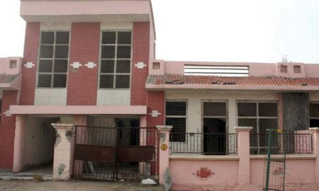 A house constructed by the Greater Noida Authority (above). Both Akhilesh Yadav (below left) and Mayawati