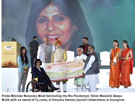 modi-felicitating-the-rio-paralympic-silver-medalist-deepa