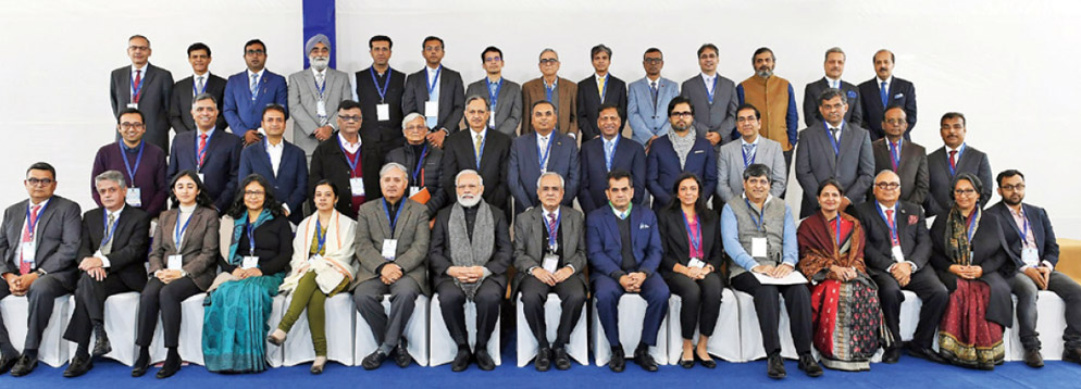 Prime Minister Narendra Modi in a group photograph with economists and experts at NITI Aayog, in New Delhi.