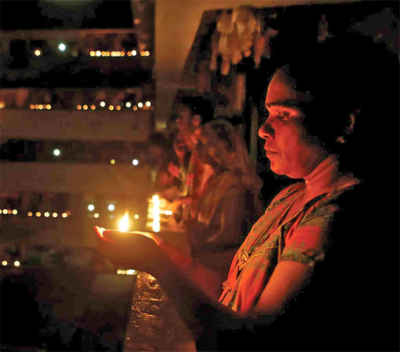 women-lighting-with-diyas-during-lockdown